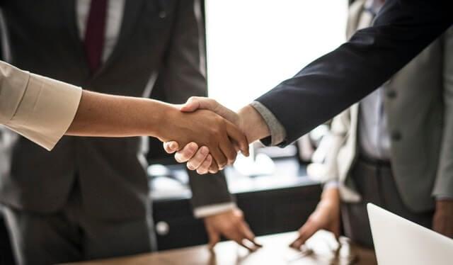 business boardroom handshake